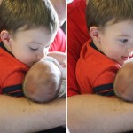 Holding his sister for the first time