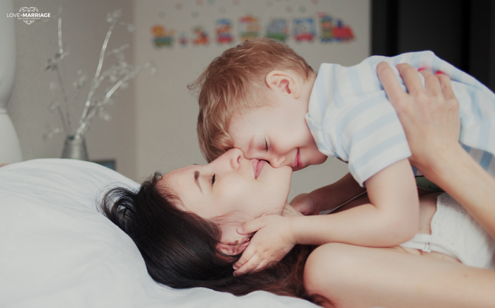 hug Mom and son on bed